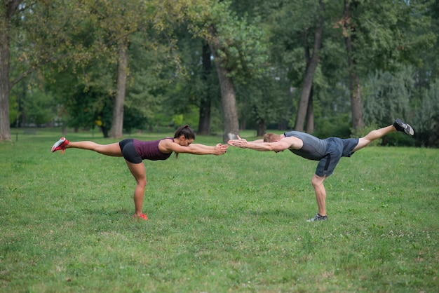 Young woman workout with her personal trainer in park