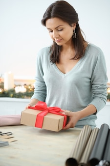 Young woman wrapping christmas presents