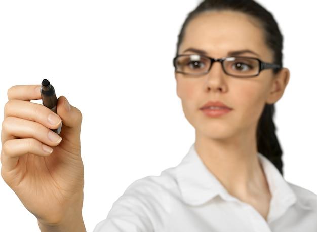 ホワイトボードマーカーで書く若い女性-孤立