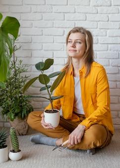 Young woman in yellow shirt gardening