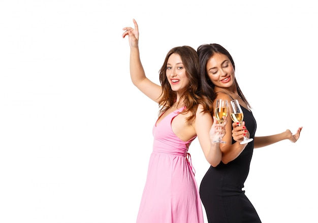 Young womans with a champagne glasses at celebration