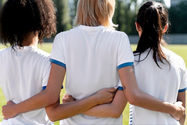 Young women being in a football team