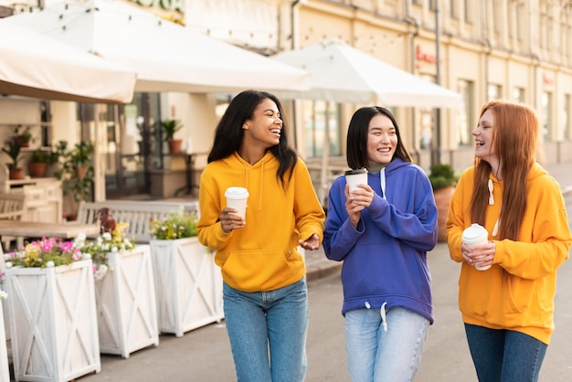 Young women being friends even with ethnicity differences