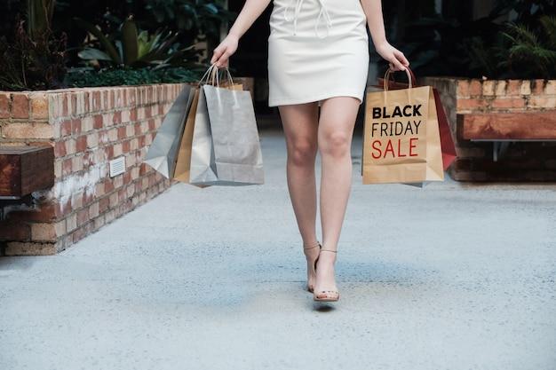 Young women carrying shopping bags