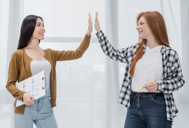 Young women celebrating together