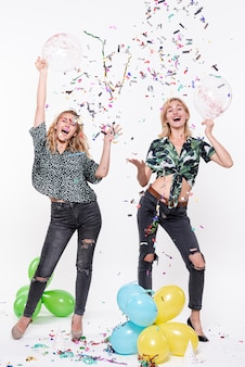 Young women celebrating with confetti