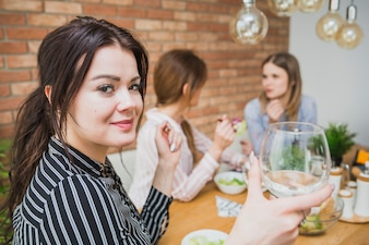 Young women drinking wine and chatting