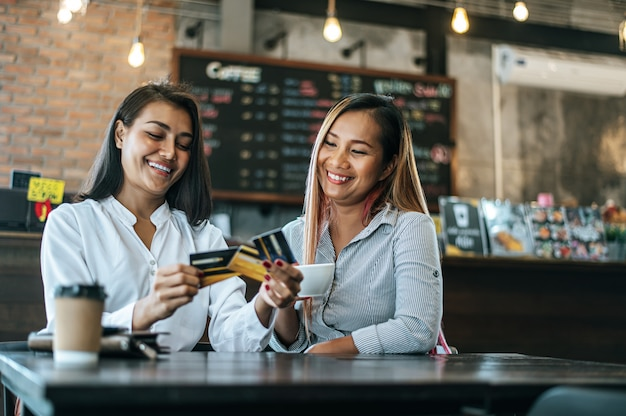 Young women enjoy shopping with credit cards.