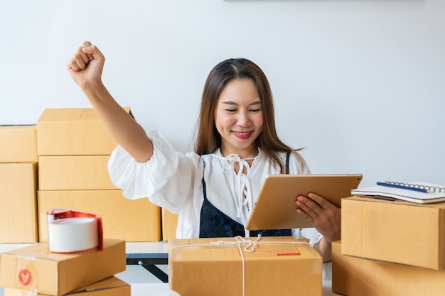 Young women happy after got big order from customer via e-mail. online shopping, work at / from home, business and technology, sme entrepreneur concept.