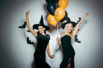 Young women having fun on Halloween party