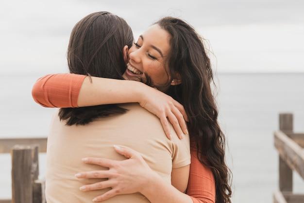 Young women hugging