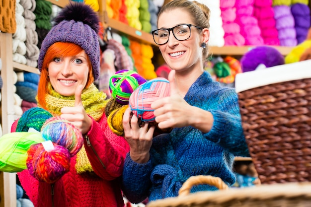 Young women in knitting fashion shop
