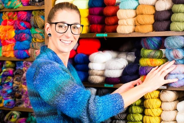 Young women in knitting shop