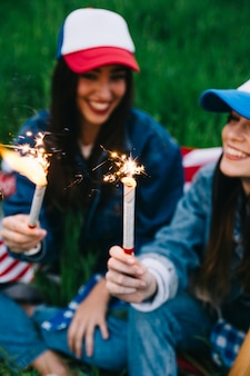 Young women laughing in park on 4th of July