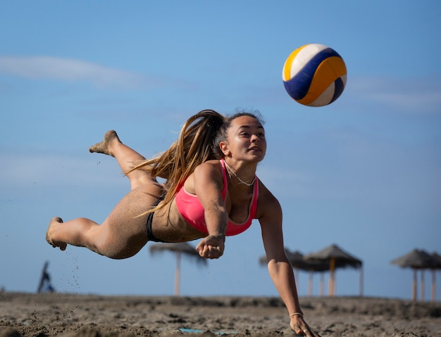 Young women playing beach volley