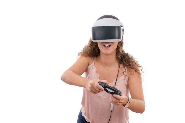 Young women playing with reality glasses and virtual console controller isolated