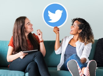 Young women showing a Twitter icon