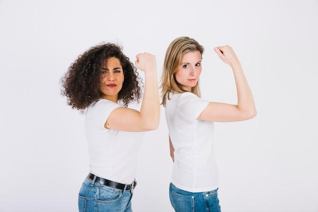 Young women showing biceps