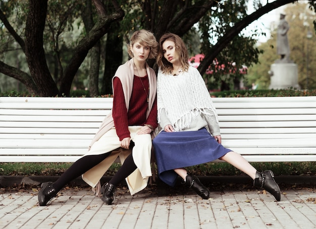 Young women sitting on a bench