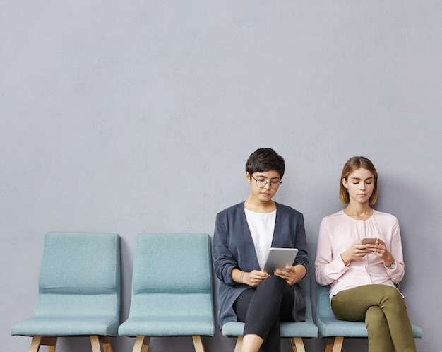 Young women sitting in waiting room