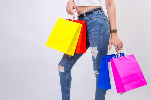 Young women with shopping on white background