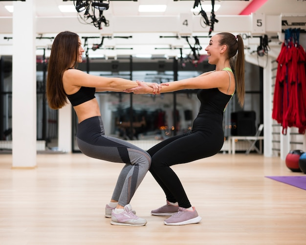 Young women working out together
