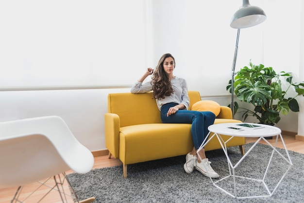 Young worker sitting on the couch
