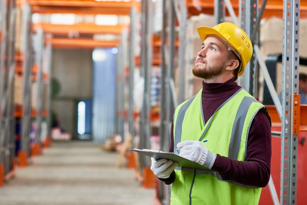 Young worker using digital tablet in  warehouse