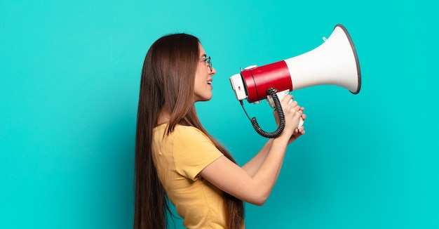 Young young woman with a megaphone