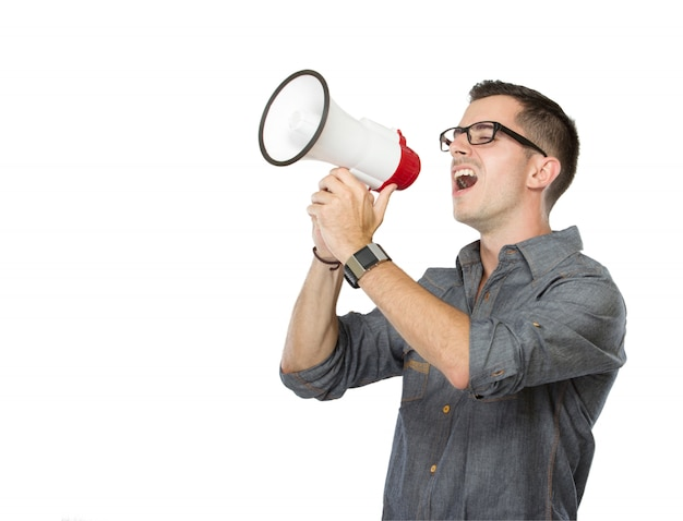 Youngman shouting through megaphone, isolated
