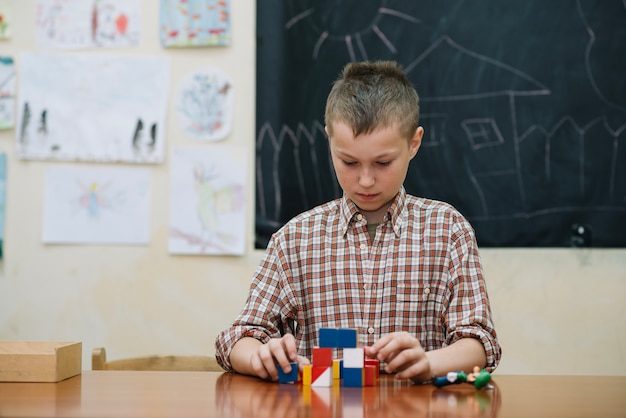 Youngster in classroom with puzzle