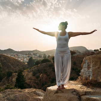 Youngwoman, yoga, nature and sunset