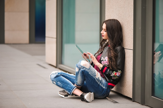 Youth and technology. attractive young woman using tablet computer outdoors.