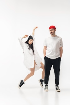 Youth. trendy fashionable couple isolated on white studio wall.