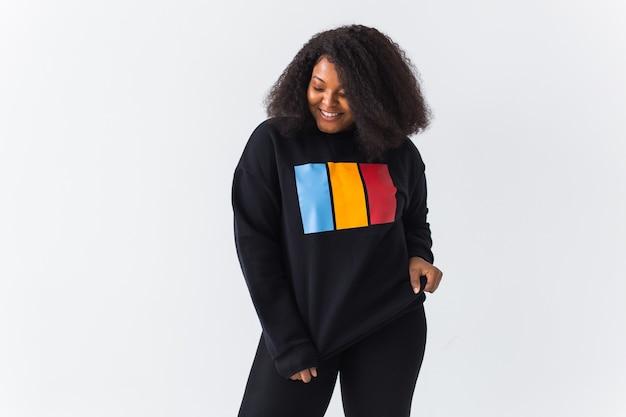 Yportrait of confident sexy black woman in stylish sweatshirt