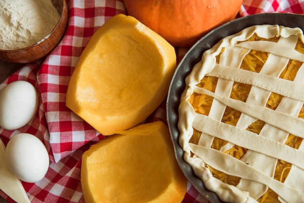 Yummy apple pie with halved pumpkins