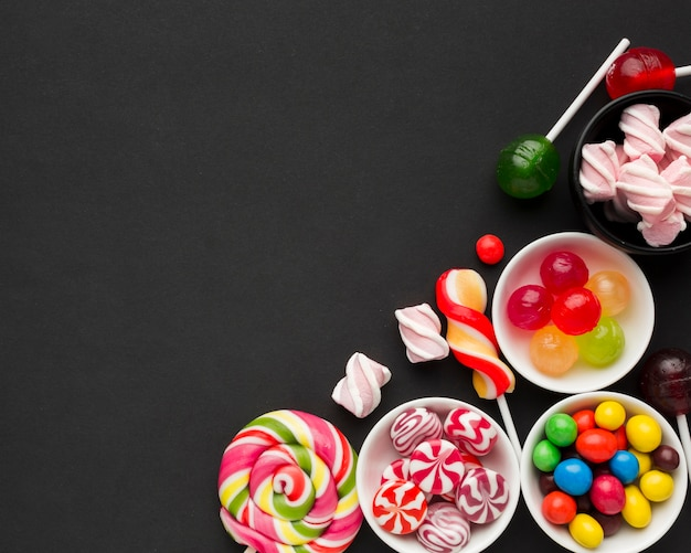 Yummy candies on black table