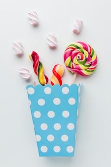 Yummy candies in popcorn bag