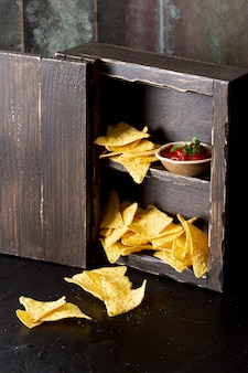 Yummy corn chips and relish in cupboard