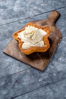 Yummy creamy cake star shaped on light,  cake biscuit cream sweet tea
