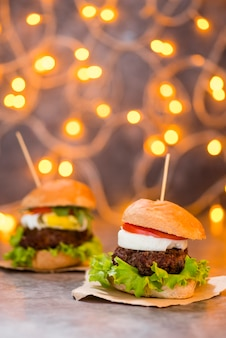 Yummy hamburgers with bokeh effect