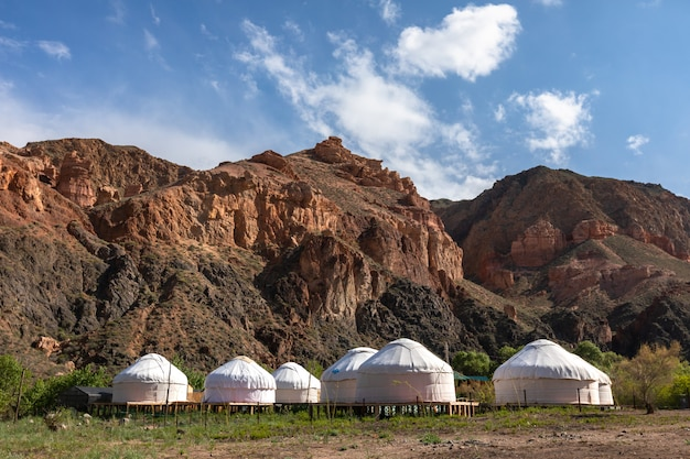 Yurt camp in mountain valley