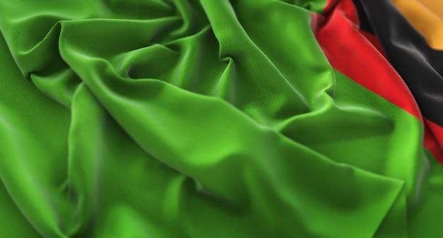 Zambia flag ruffled beautifully waving macro close-up shot