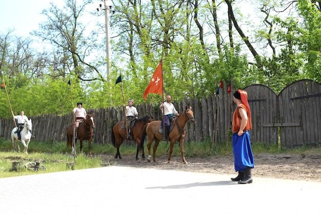 Запорожский казак из запорожского войска в национальном костюме верхом на коне