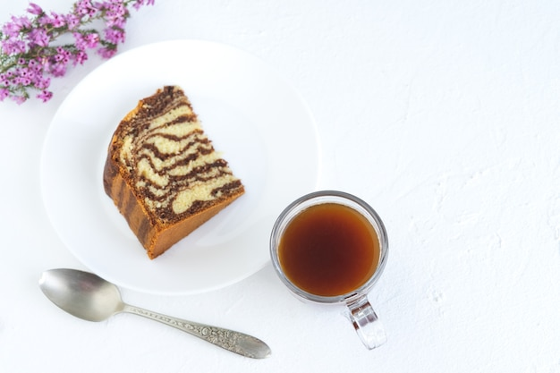 Zebra cake with coffee on white background