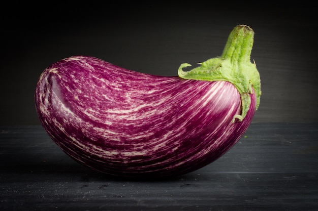 Zebra eggplant vegetable  on dark chalk background