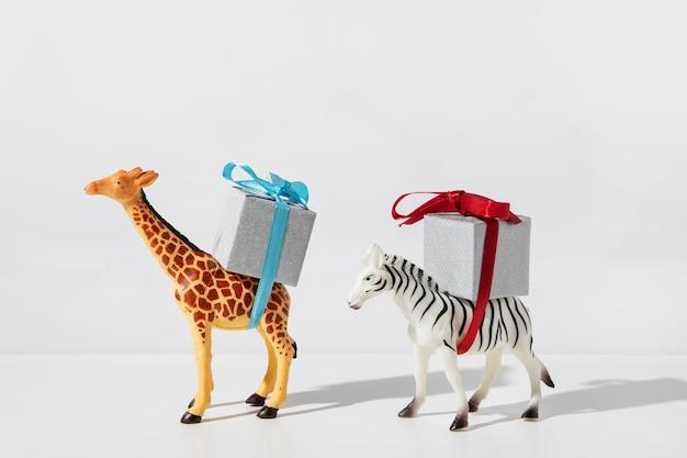 Zebra and giraffe carrying gifts