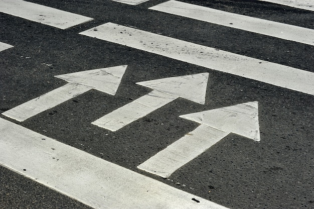Zebra pedestrian crossing the road - three arrows with the direction of movement