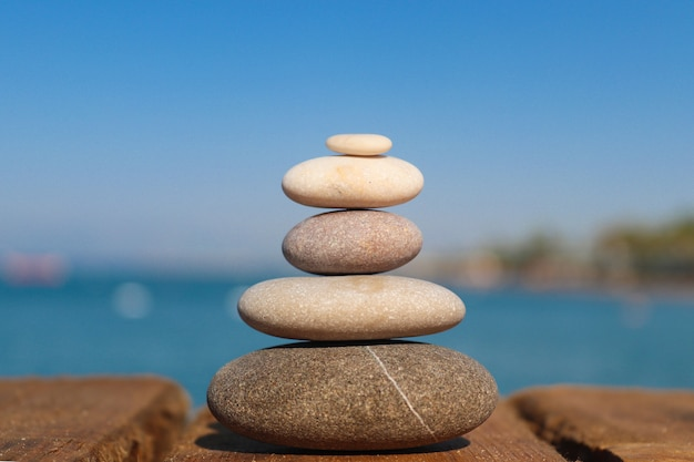 Zen concept: stack of stones on the beach. concept of harmony, stability, life balance, and meditation.