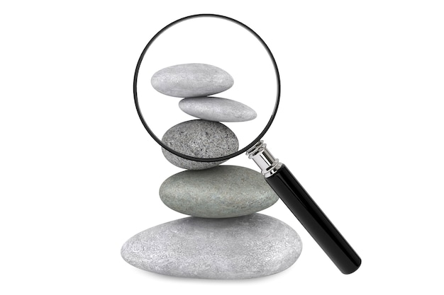 Zen garden stones and magnifying glass on a white background